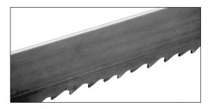 a band saw blade with heavy wear and swagging on back edge